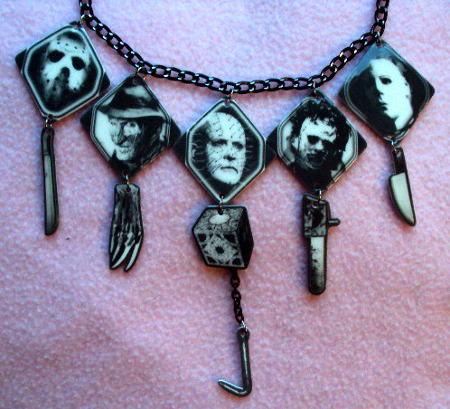 This goth-style chandelier necklace with horror movie killers features their weapon of choice dangling beneath each pendant. Via MirroredOpposites.